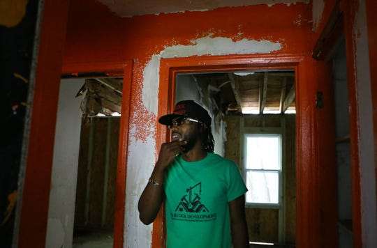 "King Yadee, 35, of Detroit is the creator of Th3 Block Development. Th3 Block Development is a construction company that purchases abandoned houses in Detroit and renovates them with the goal of ""buy back the hood."" Crew members train young people on how to fix homes and about homeownership. He owns three homes between Archdale Street and Vassar Drive that are currently being renovated."