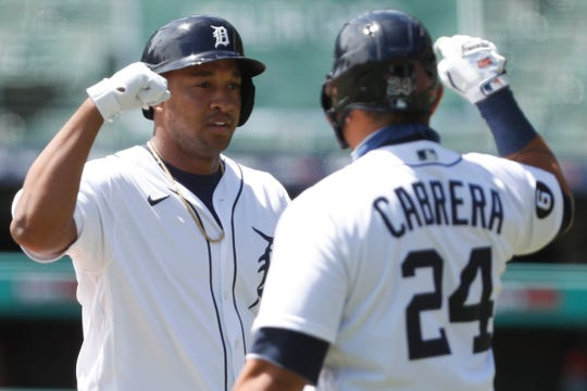 Tiger's second baseman Jonathan Shop celebrates with striker Miguel Cabrera after hitting a solo home during the first inning on Wednesday, August 12, 2020, at Comerica Park.