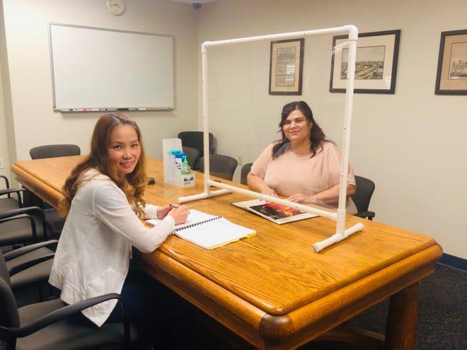 Vivi Kim and Juana Montes-Hernandez working together while practicing social distancing.