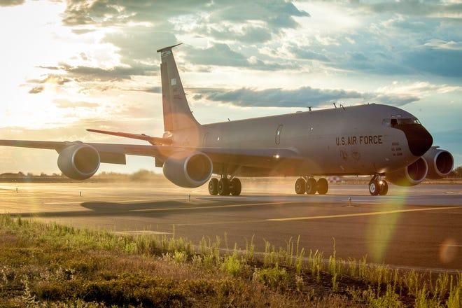 The sun sets behind a KC-135 at Fairchild Air Force Base in Washington.
