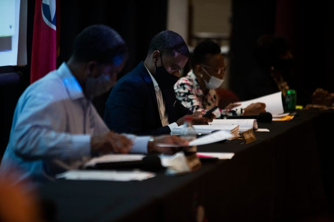 The JMC School Board of Education meet at Liberty High School in there auditorium to practice social-distancing in Jackson, Tenn., Monday, Aug. 10, 2020.