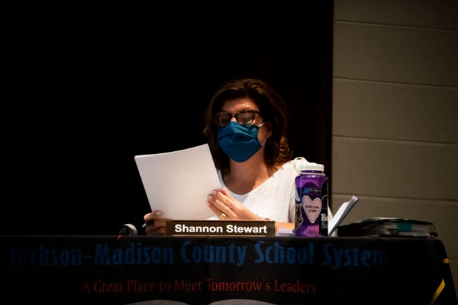 District 5, Position 2, Shannon Stewart looks over the agenda during the JMC School Board of Education meeting at Liberty High School in there auditorium to practice social-distancing in Jackson, Tenn., Monday, Aug. 10, 2020.