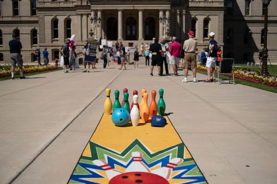People rally at the State Capitol Wednesday, Aug. 12, 2020, demanding that the state government allow bowling centers to open.