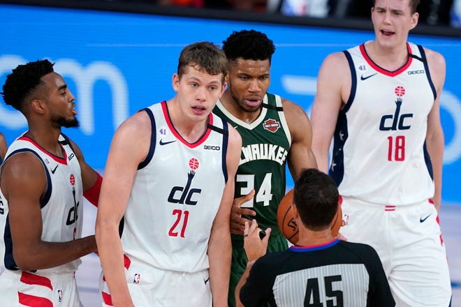 Giannis Antetokounmpo (and Moritz Wagner 34) look towards referee Brian Forte after Antetokounmpo was called for an offensive foul and ejected from the game Tuesday night after headbutting Wagner. Antetokounmpo was suspended for one game.
