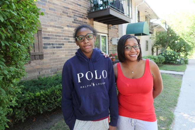 Naima Cooksey, 13, and her mother, Khola Cooksey, in front of their Wauwatosa home. Naima is going to be starting eighth grade this year with online instruction.