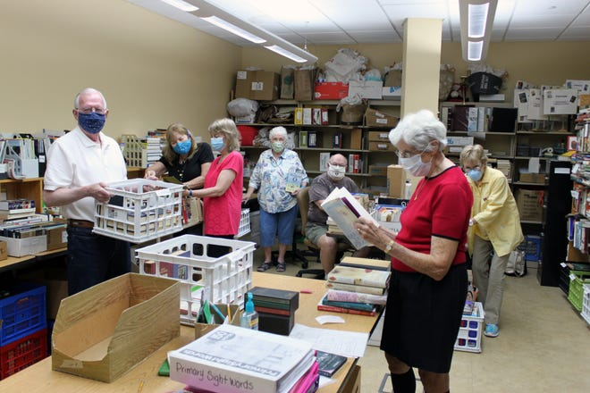 Volunteers with the Friends of the Library at work preparing for the upcoming Used Book Sale.