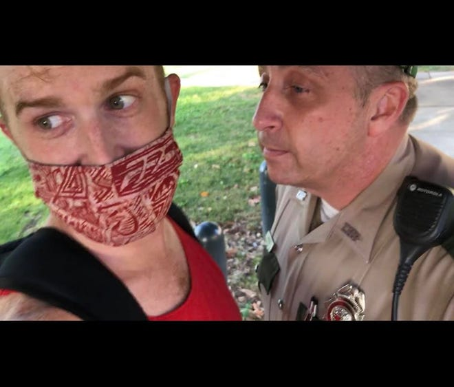 A viral video filmed by Andrew Golden, left, appears to show Tennessee Highway Patrol Trooper Harvey Briggs ripping off Golden's face mask while Golden was filming a traffic stop at the Capitol on Monday, Aug. 10, 2020.