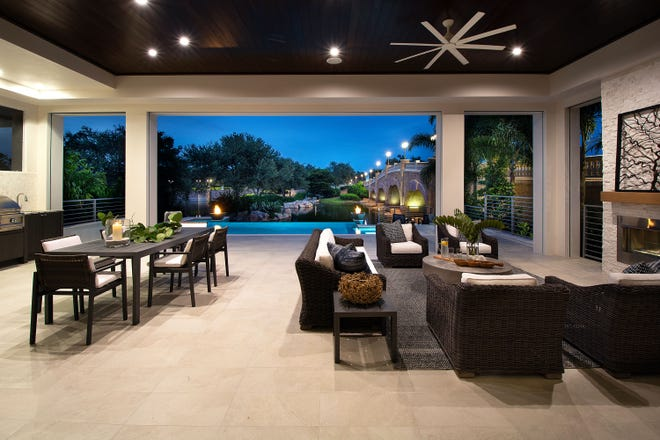 The Sonoma features an outdoor living area with conversation and dining areas, a fireplace, outdoor kitchen, pool bath, and a custom pool and spa.
