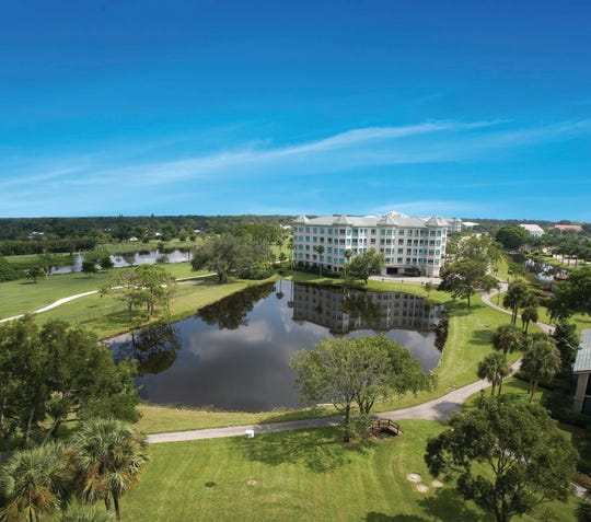 The Tower Residences in Moorings Park offer incredible views of the lake and golf course (see picture).