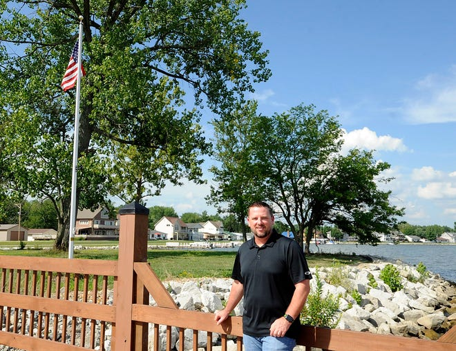 Lonnie Buckner, a long-time Marine and combat veteran, poses, ironically, on Mud Island by Buckeye Lake. Buckner started the cleaning service, Patriot Cleaning Company, after experiencing how difficult it can be to find service contractors.