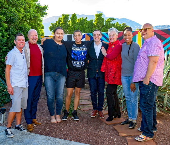 Chasten Buttigieg (husband of former presidential candidate Pete Buttigieg), center with glasses, visits with residents and staff at Sanctuary Palm Springs.