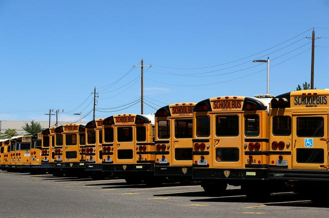 School busses are seen parked at the Washoe County School District Central Yard in Sparks on Aug. 12, 2020.