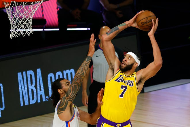 Los Angeles Lakers center  JaVale McGee attempts a shot against the Oklahoma Thunder's Steven Adams on Aug. 5 at the ESPN Wide World Of Sports Complex in Lake Buena Vista, Florida.