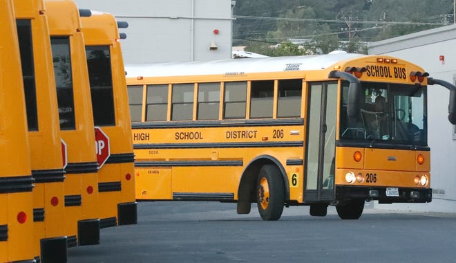 A school bus leaves the Shasta County Office of Education's transportation yard during the first day of school on Wednesday, Aug. 12, 2020. The transportation department serves students in special education programs and has a contract with the Anderson Union High School District.