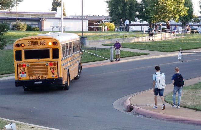 A bus arrives at Shasta High School on the first day of school on Wednesday, Aug. 12, 2020.