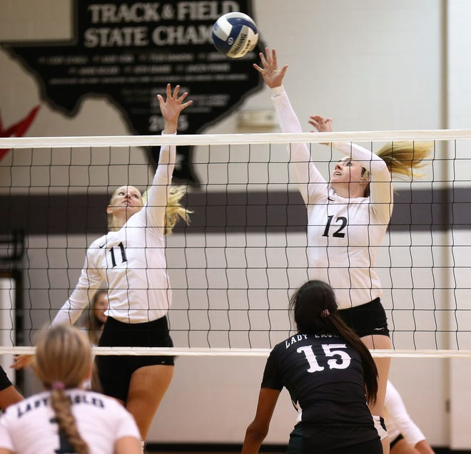 Water Valley High School's Kalysta Minton-Holland, right, and Kynlea Foltz go up for a block against Grape Creek during the season-opening volleyball match in Water Valley on Tuesday, Aug. 11, 2020.
