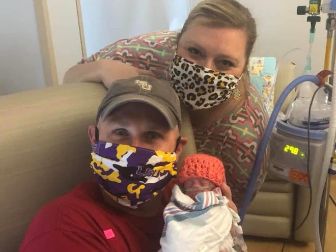 Jordan, Charlie and Piper Pate enjoy a moment together in the WK NICU. Piper weighted less than two pounds when she was born at 27 weeks on May 20.