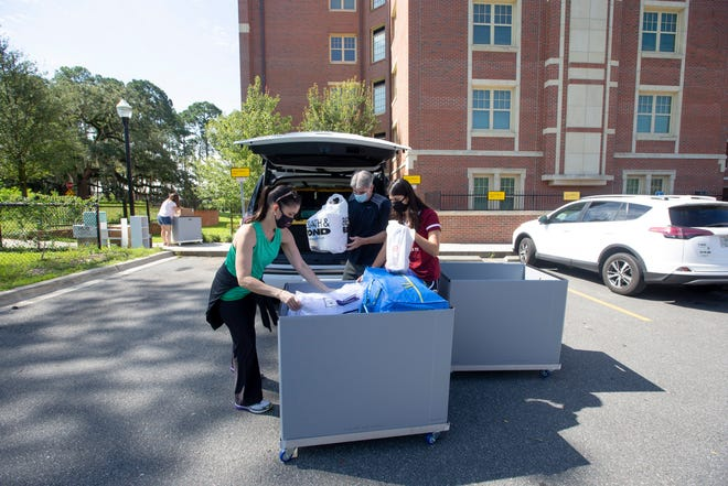 An FSU student loads up a cart while moving into Magnolia Hall for her freshman year on Wednesday, August 12, 2020.