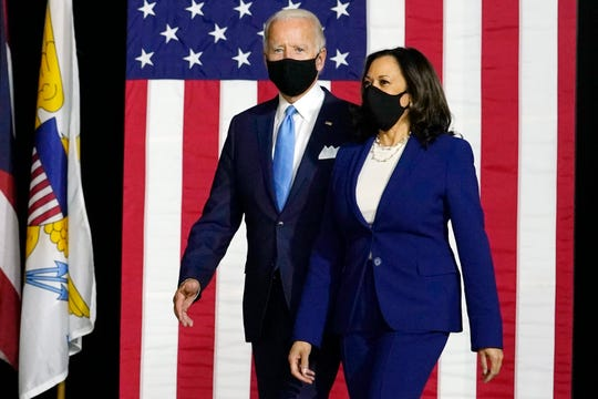Democratic presidential candidate former Vice President Joe Biden and his running mate, Sen. Kamala Harris, D-Calif., arrive to speak at a news conference at A.I. du Pont High School in Greenville on Wednesday, Aug. 12, 2020.