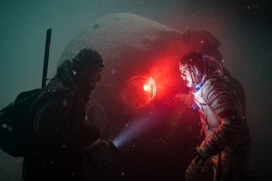 "A Soviet cosmonaut (Pyotr Fyodorov, right) returns to Earth with a dangerous alien organism inside him in the sci-fi horror ""Sputnik."""