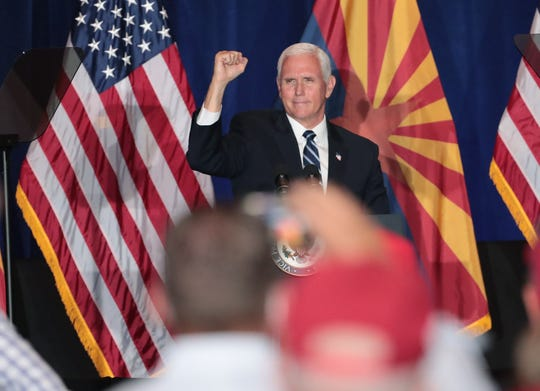 Vice President Mike Pence pumps his fist towards supporters at a