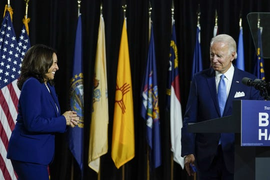 Presumptive Democratic presidential nominee former Vice President Joe Biden invites his running mate Sen. Kamala Harris (D-CA) to the stage to deliver remarks at the Alexis Dupont High School on August 12, 2020 in Wilmington, Delaware. Harris is the first Black woman and the first person of Indian descent to be nominated at the top of the presidential ticket by a major party in U.S. history.