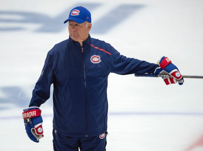 Canadiens coach Claude Julien instructs his players during practice.