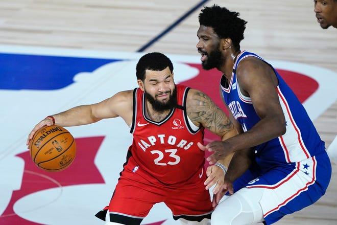 The Sixers' Joel Embiid defends the Raptors' Fred VanVleet during Wednesday night's game.