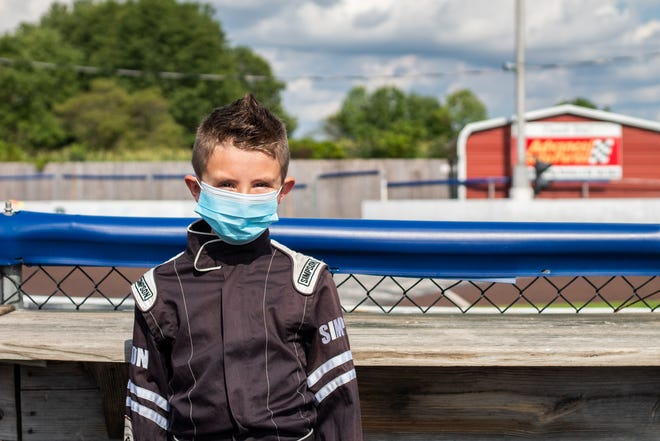 Wynne Bloom, 9, poses before his race at Oaklane Quarter Midgets in Quakertown. Races are proceeding as scheduled with some coronavirus precautions such as face masks. [MELINA WALLING/STAFF PHOTOJOURNALIST]