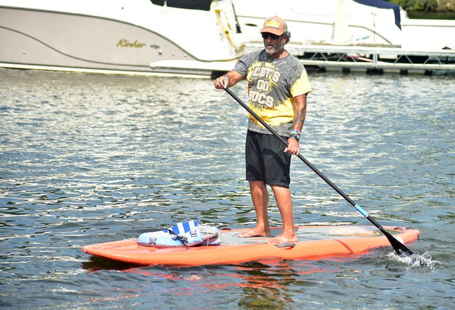 Steve Yount, owner of BVR Board Shop in Bridgewater, gives instructions on the Beaver River.  [Lucy Schaly/For BCT]