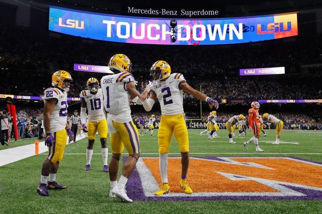 FILE - In this Jan. 13, 2020, file photo, LSU wide receiver Ja'Marr Chase (1) celebrates after scoring with wide receiver Justin Jefferson during the first half of a NCAA College Football Playoff national championship game against Clemson in New Orleans.