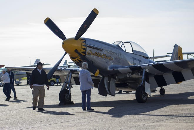 Visitors get a close-up look at some of the planes at last year's Cajun Fly-In at the Houma-Terrebonne Airport.
