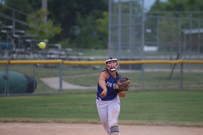 Van Meter's Molly Blomgren throws to first during a road battle with Woodward-Granger.