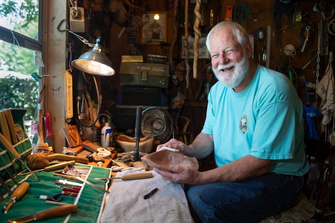 Kent Kepley sands a bird bowl at his workshop. The bird bowl originated from a piece of wood brought down during Hurricane Isabel in 2003 on Ocracoke Island. Kepley saved the wood in his shop for many years and is now making bowls with it.