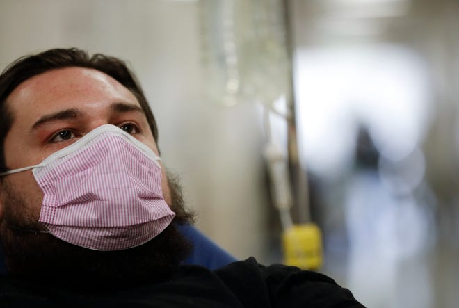 Donnie Cardenas recovers from the flu at the Palomar Medical Center in Escondido, Calif. in this Jan. 10, 2017 file photo. The 2017 flu year saw 132 deaths in Volusia County due to flu or pneumonia. So far this year, 151 Volusia County residents' deaths have been attributed to the coronavirus, with months left to go in the calendar year. (AP File Photo/Gregory Bull)