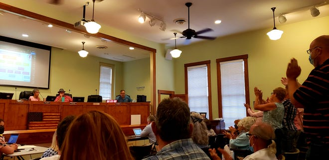 Some residents stand and applaud Vice Mayor Jim Connell, seated at the far right of the dais, following his comments during a special meeting on Wednesday, Aug. 12, 2020.