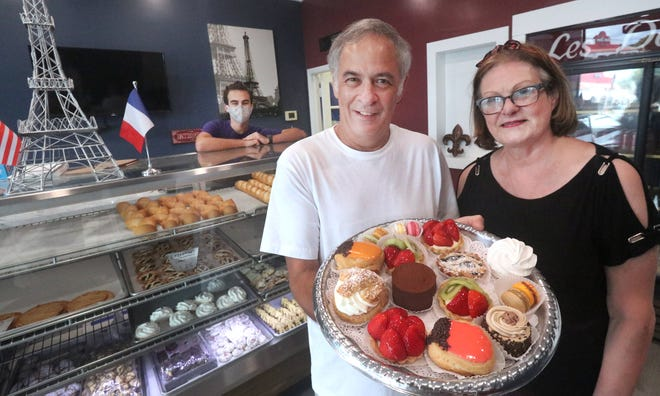 Jean and Francoise Jenner, along with son Preston, behind the counter, display their creations at The French Bakery in Ormond Beach. The family-owned business has been going strong for 36 years. News-Journal/David Tucker