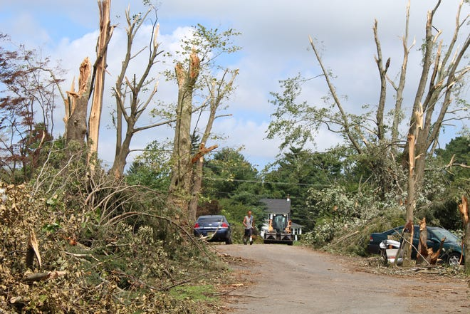 A file photo of the view down Manor Drive near Moore's Lake a couple days after the storm. Volunteers will be working in Richardson Circle off Route 10 Saturday, Aug. 15.