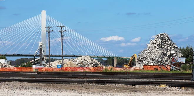 The ADM grain elevator silos are in rubble after demolition Sunday on the Burlington riverfront.