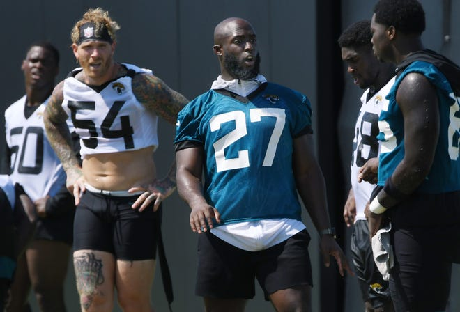 Jaguars RB Leonard Fournette talks with teammates between sprints at the end of practice on Aug. 13.