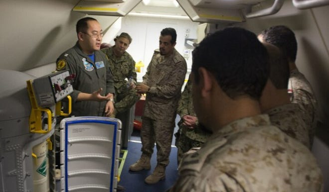 U.S. Navy Lt. Fan Yang (left) explains systems in the P-8A Poseidon aircraft in this 2018 photo.