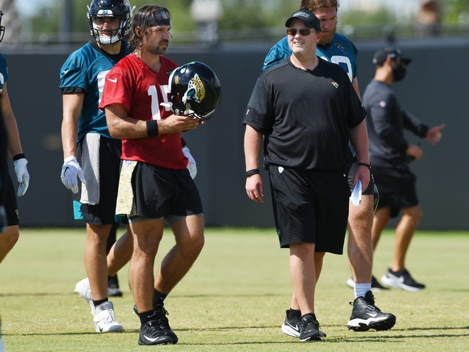 Jaguars starting quarterback #15, Gardner Minshew II walks with quarterbacks Coach Ben McAdoo during Thursday morning's practice session. The Jacksonville Jaguars training camp practice session held at the practice fields outside TIAA Bank Field in Jacksonville, Florida Thursday August 13, 2020. [Bob Self/Florida Times-Union]