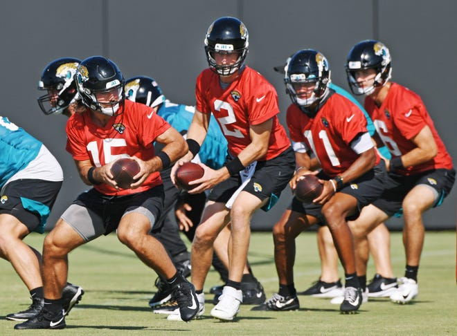 The Jaguars quarterback squad led by #15, Gardner Minshew II during drills at Thursday's practice session. The Jacksonville Jaguars training camp practice session held at the practice fields outside TIAA Bank Field in Jacksonville, Florida Thursday August 13, 2020. [Bob Self/Florida Times-Union]