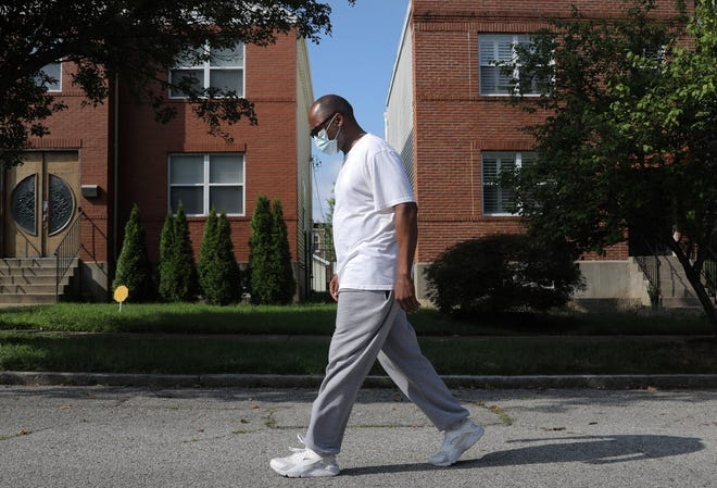 Rodrick Cunningham takes a short walk on his Grand Center neighborhood block on Monday, Aug. 3. Mask mandates in St. Louis and St. Louis County slowed the spread of the coronavirus this summer when compared to neighboring counties that didn't require face masks, a Saint Louis University study found.