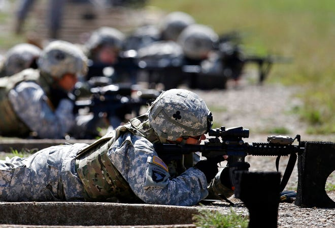 """FILE - In this Sept. 18, 2012, file photo, female soldiers from 1st Brigade Combat Team, 101st Airborne Division train on a firing range while testing new body armor in Fort Campbell, Ky.  A federal appeals court in New Orleans upheld the constitutionality of the all-male military draft system Thursday, Aug. 13, 2020, citing a 1981 U.S. Supreme Court decision. The 5th U.S. Circuit Court of Appeals in New Orleans said """"only the Supreme Court may revise its precedent."""" (AP Photo/Mark Humphrey, File)"""