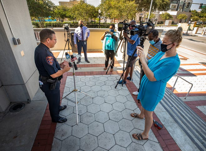 Lakeland Police Chief Ruben Garcia answers questions during a news conference at department headquarters Tuesday. LPD is investigating a crash that occurred when a man fleeing police in an alleged stolen car had a near head-on collision with a 19-year-old woman driving with her infant in her car. [ERNST PETERS/THE LEDGER]