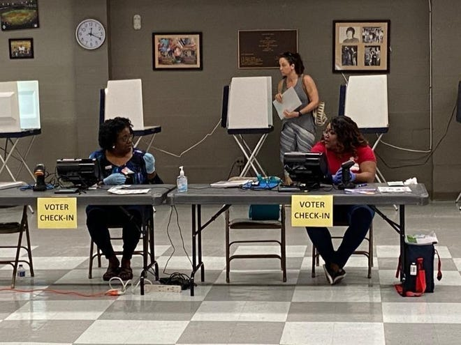 Poll workers at a Florida voting precinct.