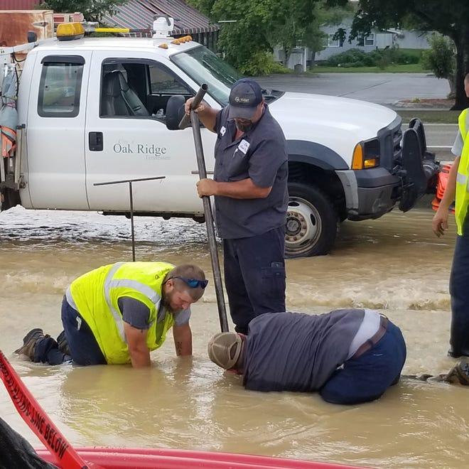 An emergency water main repair was underway at the corner of Rutgers Avenue and Oak Ridge Turnpike.