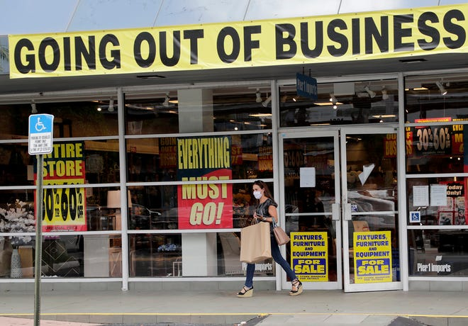 A customer leaves a Pier 1 store in Coral Gables. The retailer is going out of business, aiming to close its remaining 500 stores by October.