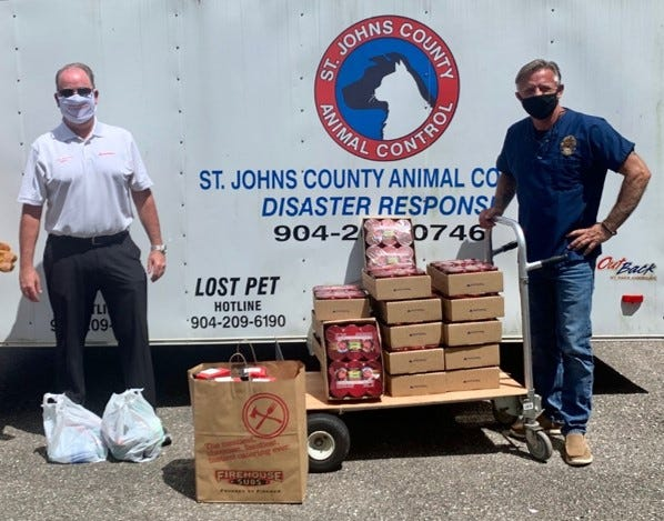Craig Dewhurst, local State Farm agent, donates pet food to the residents of the St John's County Animal Control Pet Center and lunch to the volunteers. (Contributed photo)